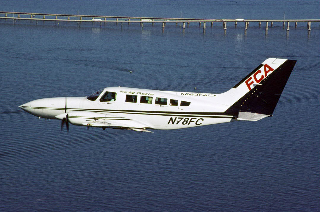 Florida Coastal began flying in 1995 with routes from the Florida mainland to the Keys and the Bahamas using a fleet of 9-passenger Cessna 402s. The carrier was based at Ft. Pierce, Florida.  Cessna 402 N78FC is seen flying above the 7 Mile Bridge in the Florida Keys, circa 2004.