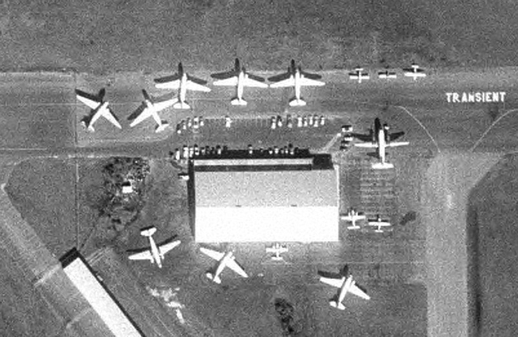 Eight DC-3s and a Martin 404 are among the many aircraft parked at the Florida Airlines maintenance base in Sarasota in this December 7, 1977 Department of Transportation aerial photo.