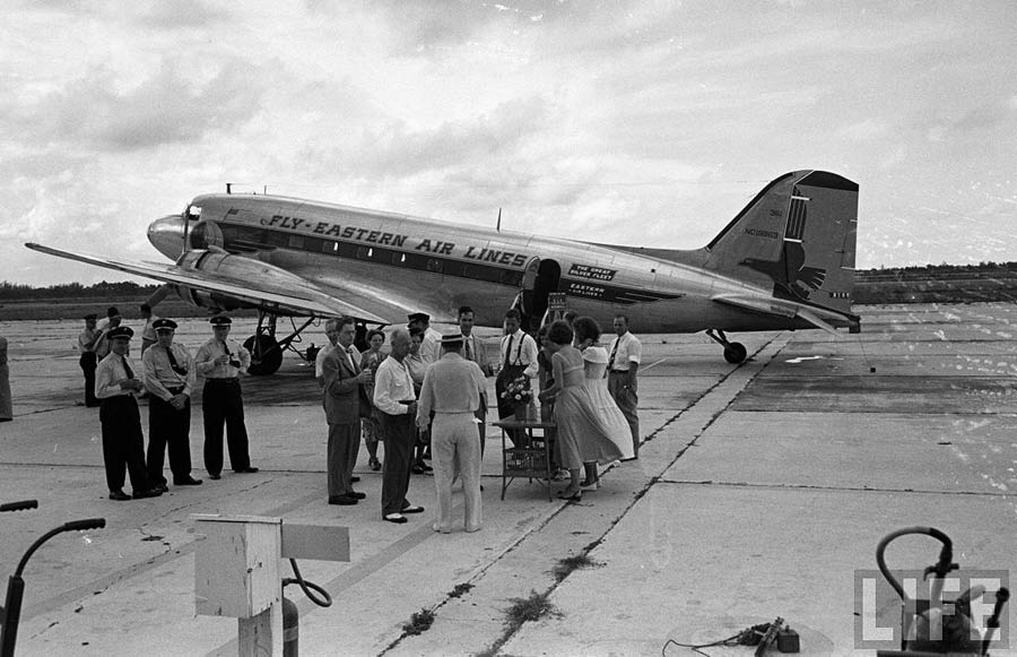 Loading luggage and freight onto NC19963. This particular aircraft was delivered to Eastern in 1940 and was one of the few DC-3s not pressed into wartime service.