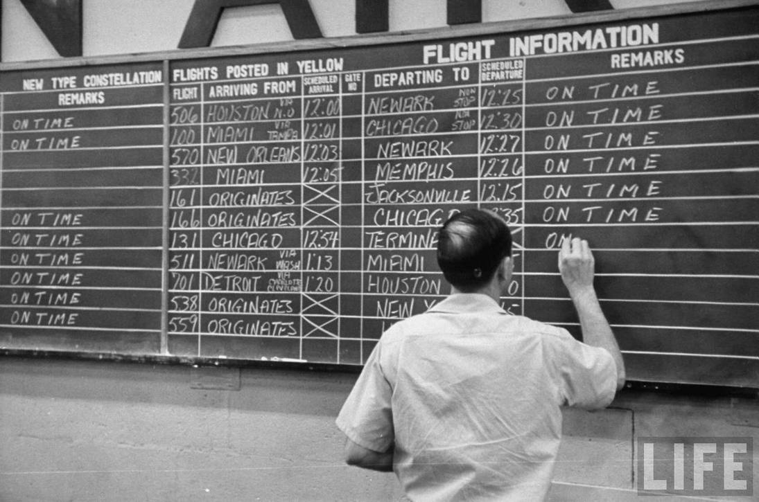 Before the days of computers: Eastern Air Lines arrivals and departures handwritten in chalk.