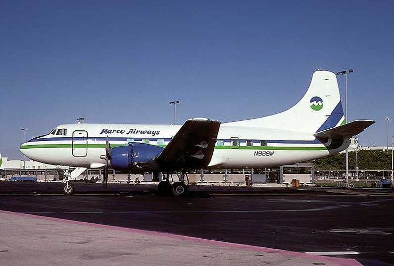 Martin 404 N969M pictured at Miami in 1984, with shortened Marco Airways titles and Air Florida colors.